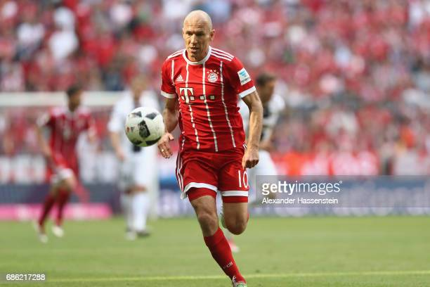 Arjen Robben of Bayern Muenchen runs with the ball during the Bundesliga match between Bayern Muenchen and SC Freiburg at Allianz Arena on May 20...
