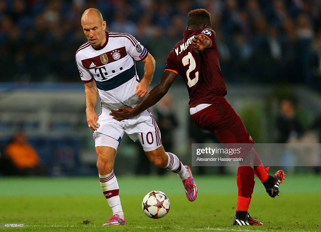 <a gi-track='captionPersonalityLinkClicked' href=/galleries/search?phrase=Arjen+Robben&family=editorial&specificpeople=194740 ng-click='$event.stopPropagation()'>Arjen Robben</a> of Bayern Muenchen runs with the ball past <a gi-track='captionPersonalityLinkClicked' href=/galleries/search?phrase=Mapou+Yanga-Mbiwa&family=editorial&specificpeople=6665294 ng-click='$event.stopPropagation()'>Mapou Yanga-Mbiwa</a> of AS Roma during the UEFA Champions League group E match between AS Roma and FC Bayern Muenchen at Stadio Olimpico on October 21, 2014 in Rome, Italy.