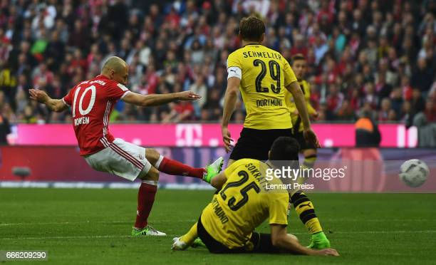 Arjen Robben of Bayern Muenchen scores his sides third goal during the Bundesliga match between Bayern Muenchen and Borussia Dortmund at Allianz...