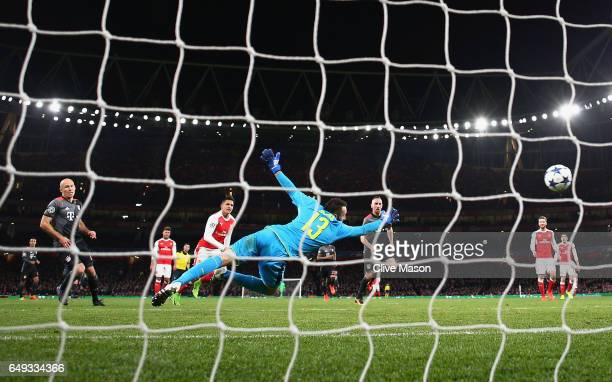 Arjen Robben of Bayern Muenchen scores their second goal past goalkeeper David Ospina of Arsenal during the UEFA Champions League Round of 16 second...