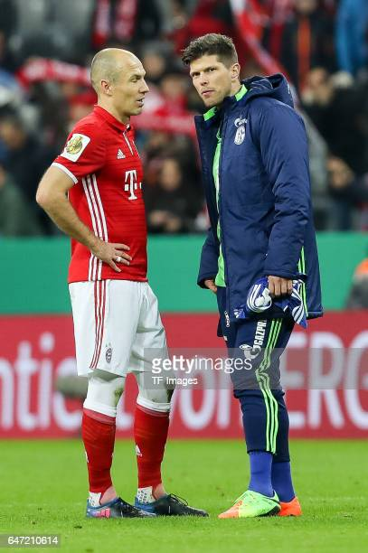 Arjen Robben of Bayern Muenchen speak with KlaasJan Huntelaar of Schalke diskutieren during the DFB Cup quarter final between Bayern Muenchen and FC...