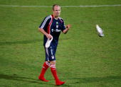 Arjen Robben of Bayern Muenchen throws his shoe during the FC Bayern Muenchen training session at the Al Nasr training ground on January 6 2010 in...