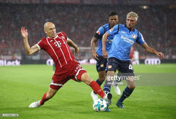 Arjen Robben of Bayern Muenchen with Kevin Kampl of Bayer Leverkusen during the Bundesliga match between FC Bayern Muenchen and Bayer 04 Leverkusen...