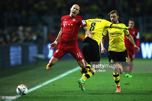 Arjen Robben of Bayern Munich and Ilkay Gundogan of Borussia Dortmund during the Bundesliga match between Borussia Dortmund and FC Bayern Muenchen at...