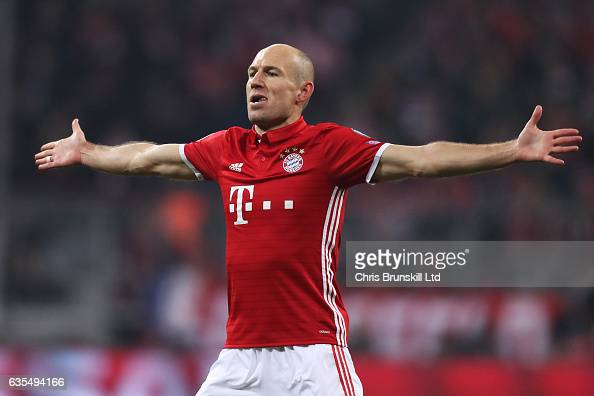 Arjen Robben of Bayern Munich celebrates scoring the first goal during the UEFA Champions League Round of 16 first leg match between FC Bayern...