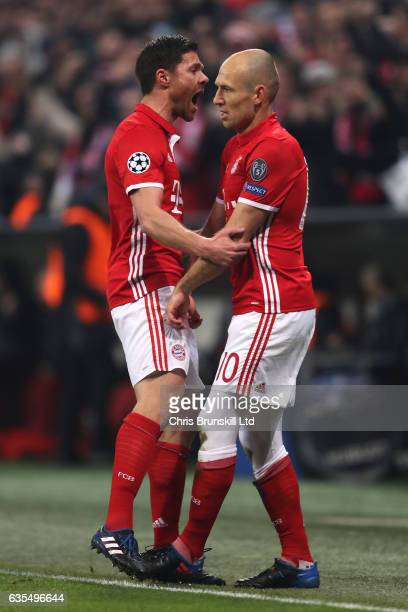 Arjen Robben of Bayern Munich celebrates with his teammate Xabi Alonso after scoring the first goal during the UEFA Champions League Round of 16...