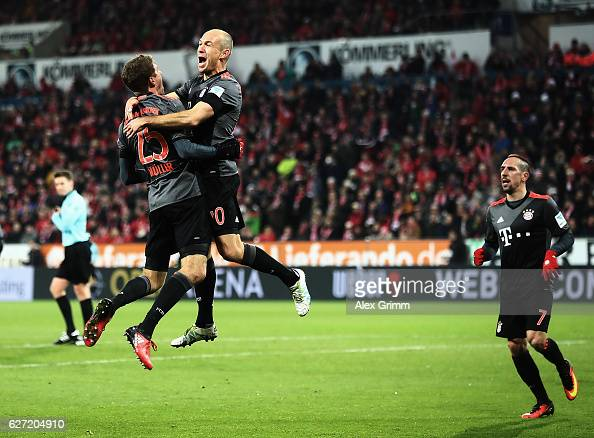 Arjen Robben of Bayern Munich is congratulated by Thomas Mueller after scoring a goal during the Bundesliga match between 1 FSV Mainz 05 and Bayern...