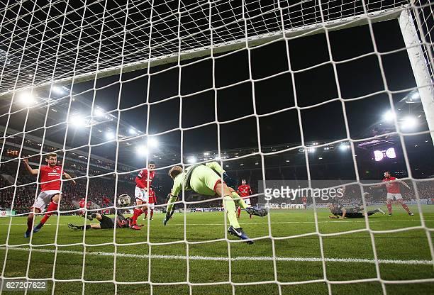 Arjen Robben of Bayern Munich scores a goal past Jonas Loessl of FSV Mainz 05 during the Bundesliga match between 1 FSV Mainz 05 and Bayern Muenchen...