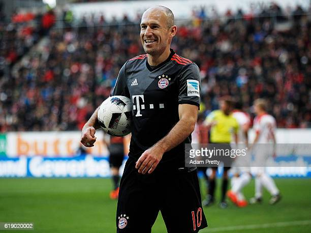 Arjen Robben of Bayern Munich smiles after not being awarded a penalty during the Bundesliga match between FC Augsburg and Bayern Muenchen at WWK...
