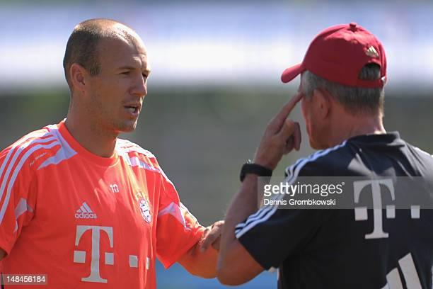 Arjen Robben of Bayern talks to head coach Jupp Heynckes during day three of the Bayern Muenchen preseason training camp at Arco Stadium on July 17...