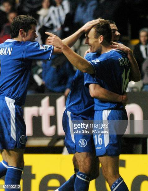 Arjen Robben of Chelsea is congratulated by Mateja Kezman after scoring against Newcastle United during the Carling Cup fourth round match at St...