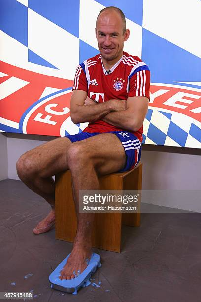 Arjen Robben of FC Bayern casts his feet that will be part of the German Footballs Associations Walk of Fame on October 2 2014 in Munich Germany...