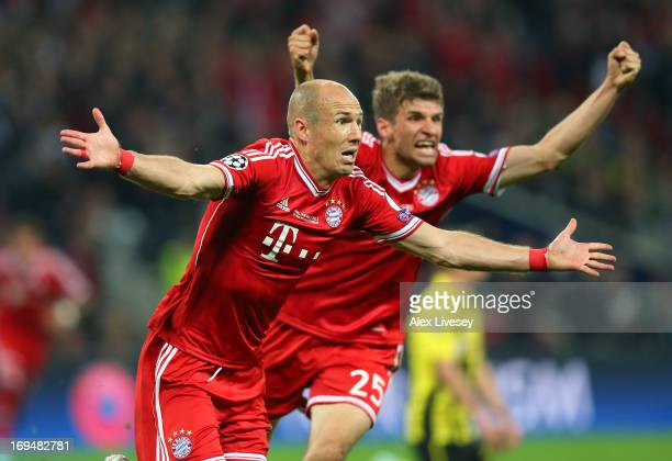 Arjen Robben of FC Bayern Muenchen celebrates after scoring the winning goal during the UEFA Champions League final match between Borussia Dortmund...