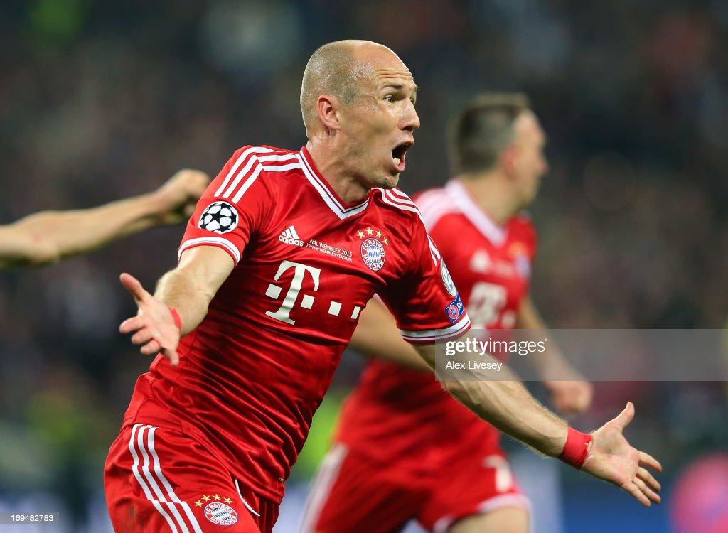 <a gi-track='captionPersonalityLinkClicked' href=/galleries/search?phrase=Arjen+Robben&family=editorial&specificpeople=194740 ng-click='$event.stopPropagation()'>Arjen Robben</a> of FC Bayern Muenchen celebrates after scoring the winning goal during the UEFA Champions League final match between Borussia Dortmund and FC Bayern Muenchen at Wembley Stadium on May 25, 2013 in London, United Kingdom.