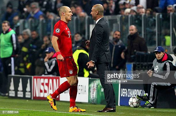 Arjen Robben of FC Bayern Muenchen celebrates his goal with his coach Josep Guardiola during the UEFA Champions League Round of 16 first leg match...