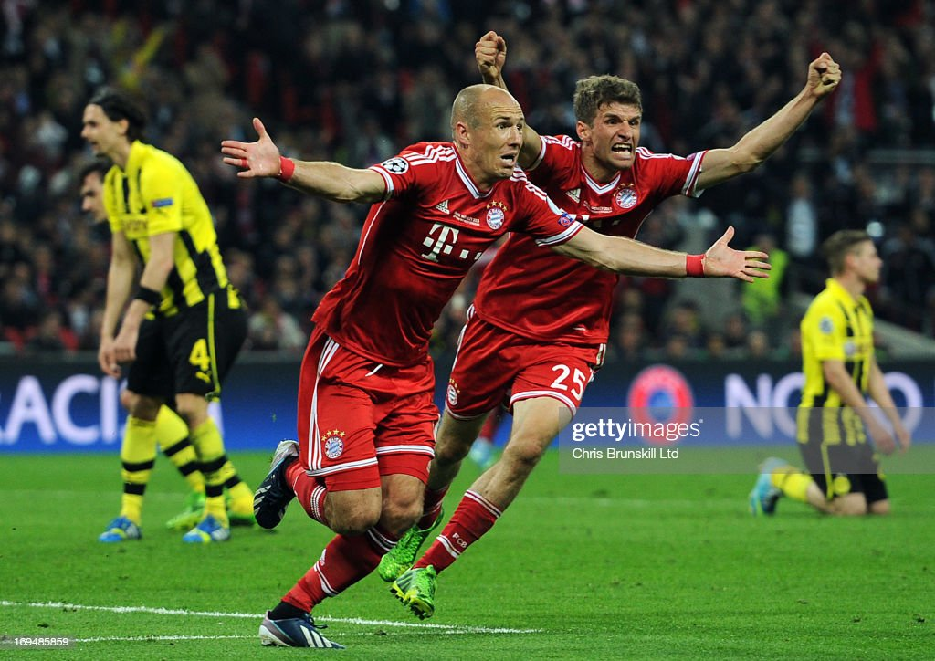 <a gi-track='captionPersonalityLinkClicked' href=/galleries/search?phrase=Arjen+Robben&family=editorial&specificpeople=194740 ng-click='$event.stopPropagation()'>Arjen Robben</a> of FC Bayern Muenchen celebrates scoring his side's second goal with team-mate Thomas Muller during the UEFA Champions League final match between Borussia Dortmund and FC Bayern Muenchen at Wembley Stadium on May 25, 2013 in London, England.