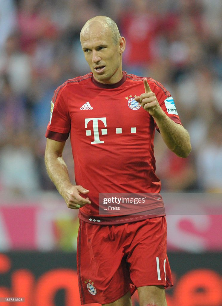 Arjen Robben of FC Bayern Muenchen celebrates scoring his team's third goal during the Bundesliga match between FC Bayern Muenchen and Bayer...