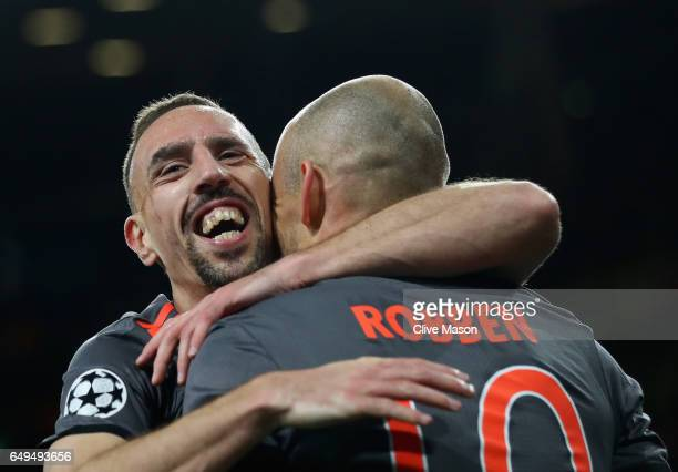 Arjen Robben of FC Bayern Muenchen celebrates with Franck Ribery of FC Bayern Muenchen as he scores their second goal during the UEFA Champions...