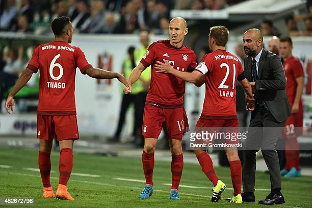 Arjen Robben of FC Bayern Muenchen celebrates with team mates as he scores the first goal during the DFL Supercup 2015 match between VfL Wolfsburg...