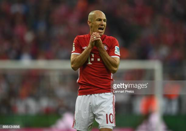 Arjen Robben of FC Bayern Muenchen gestures after a missed chance during the Bundesliga match between Bayern Muenchen and Borussia Dortmund at...