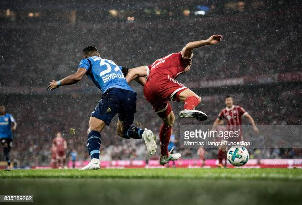 Arjen Robben of FC Bayern Muenchen is challenged by Benjamin Henrichs of Leverkusen during the Bundesliga match between FC Bayern Muenchen and Bayer...