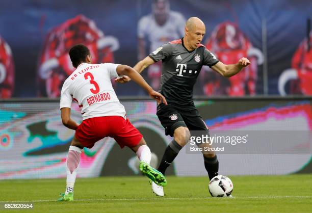 Arjen Robben of FC Bayern Muenchen is challenged by Bernardo of RB Leipzig during the Bundesliga match between RB Leipzig and Bayern Muenchen at Red...