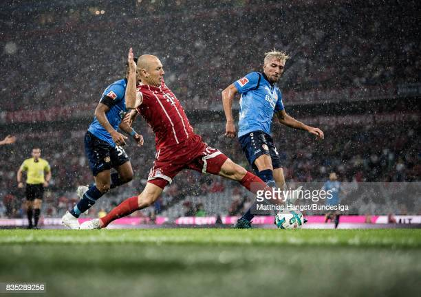 Arjen Robben of FC Bayern Muenchen is challenged by Kevin Kampl of Leverkusen during the Bundesliga match between FC Bayern Muenchen and Bayer 04...
