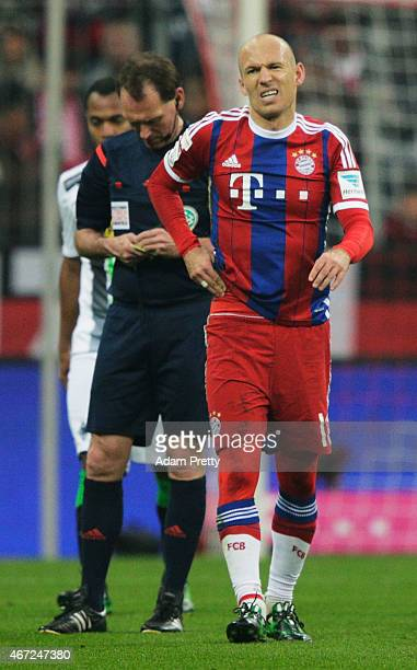 Arjen Robben of FC Bayern Muenchen is fouled and njured during the Bundesliga match between Bayern Muenchen and Borussia Moenchengladbach at Allianz...