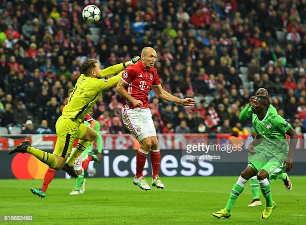 Arjen Robben of FC Bayern Muenchen scores his team's fourth goal against Jeroen Zoet of PSV Eindhoven during the UEFA Champions League match between...