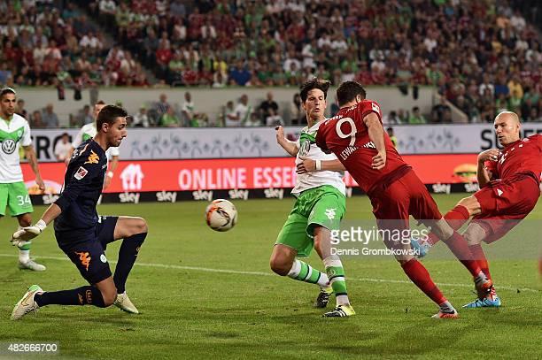 Arjen Robben of FC Bayern Muenchen scores the first goal past Koen Casteels of VfL Wolfsburg during the DFL Supercup 2015 match between VfL Wolfsburg...