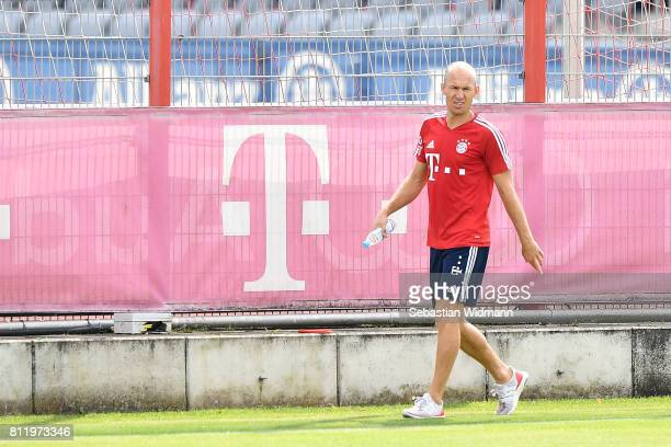 Arjen Robben of FC Bayern Muenchen walks along a fence at Saebener Strasse training ground on July 10 2017 in Munich Germany