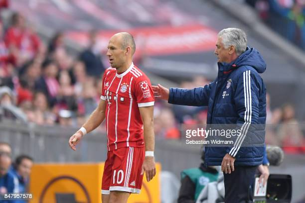Arjen Robben of FC Bayern Muenchen walks past head coach Carlo Ancelotti of FC Bayern Muenchen after his substitution during the Bundesliga match...