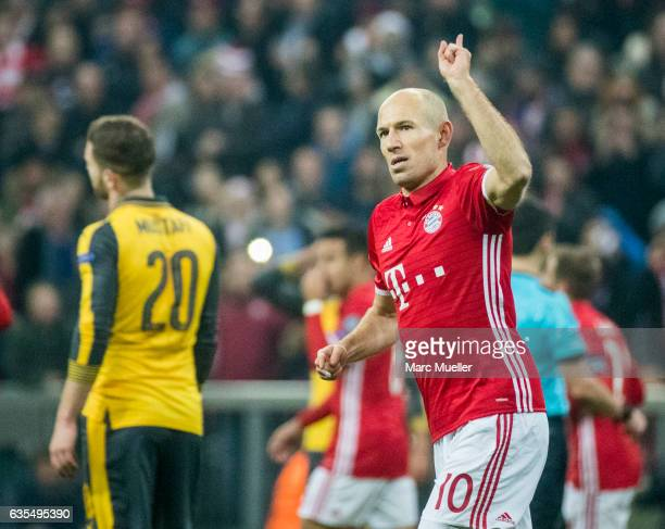 Arjen Robben of FC Bayern Munich celebrates after scoring the opening goal during the UEFA Champions League Round of 16 first leg match between FC...