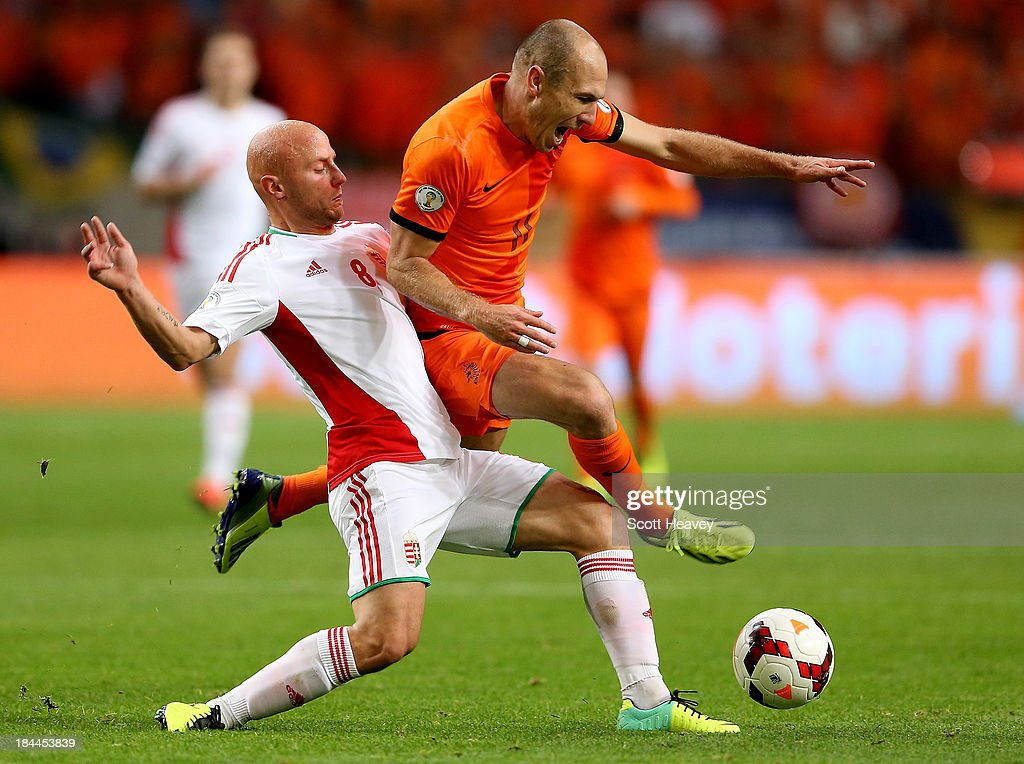 <a gi-track='captionPersonalityLinkClicked' href=/galleries/search?phrase=Arjen+Robben&family=editorial&specificpeople=194740 ng-click='$event.stopPropagation()'>Arjen Robben</a> of Holland in action withJozsef Varga of Hungary during the FIFA 2014 World Cup Qualifing match between Holland and Hungary at Amsterdam Arena on October 11, 2013 in Amsterdam, Netherlands.