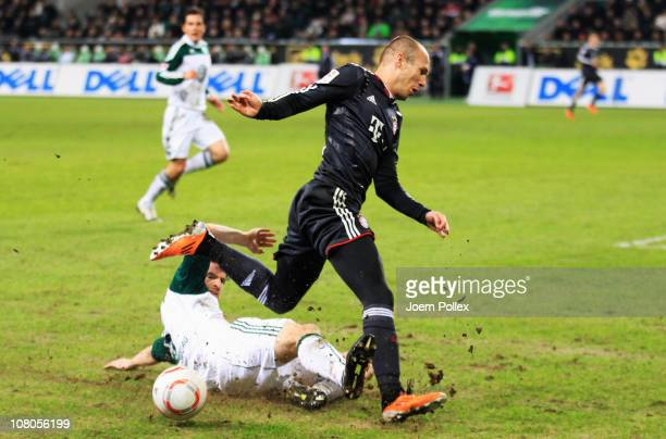 Arjen Robben of Muenchen and Arne Friedrich of Wolfsburg battle for the ball during the Bundesliga match between VfL Wolfsburg and FC Bayern Muenchen...
