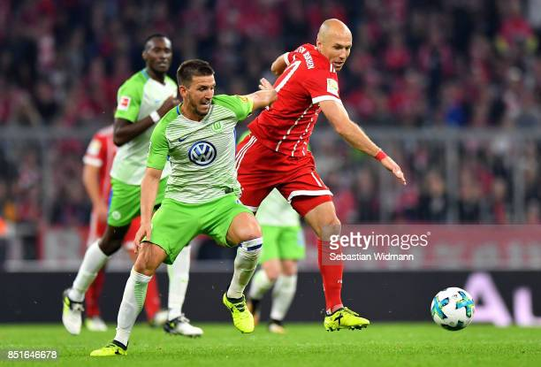 Arjen Robben of Muenchen and Ignacio Camacho of Wolfsburg battle for the ball during the Bundesliga match between FC Bayern Muenchen and VfL...