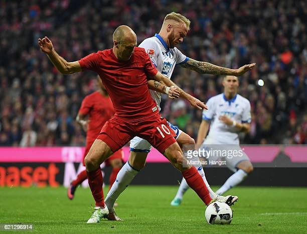 Arjen Robben of Muenchen and Kevin Vogt of Hoffenheim compete for the ball during the Bundesliga match between Bayern Muenchen and TSG 1899...