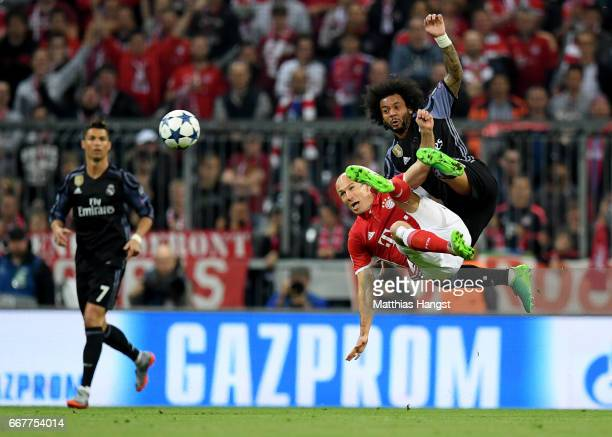 Arjen Robben of Muenchen and Marcelo of Real Madrid battle for the ball during the UEFA Champions League Quarter Final first leg match between FC...