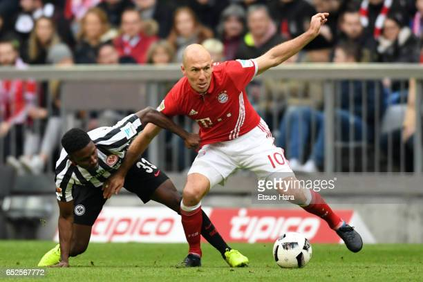Arjen Robben of Muenchen and Taleb Tawatha of Frankfurt compete for the ball during the Bundesliga match between Bayern Muenchen and Eintracht...