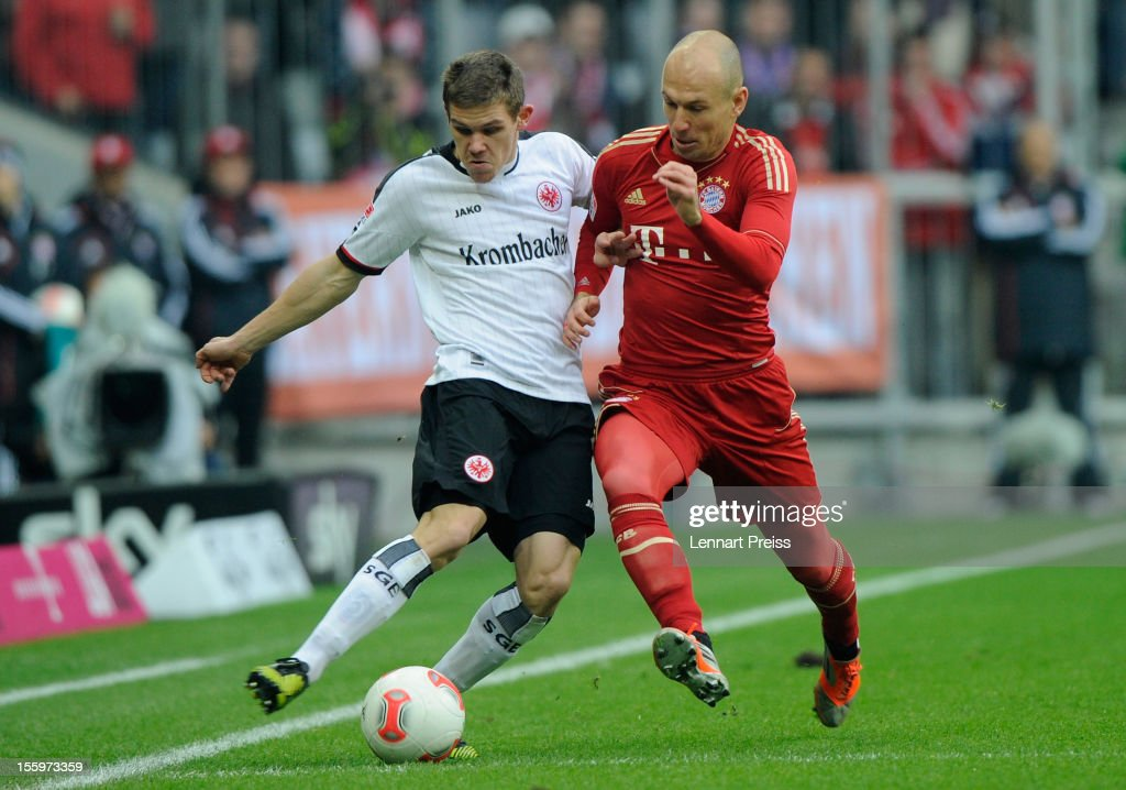 <a gi-track='captionPersonalityLinkClicked' href=/galleries/search?phrase=Arjen+Robben&family=editorial&specificpeople=194740 ng-click='$event.stopPropagation()'>Arjen Robben</a> (R) of Muenchen battles for the ball with <a gi-track='captionPersonalityLinkClicked' href=/galleries/search?phrase=Sebastian+Jung&family=editorial&specificpeople=4645123 ng-click='$event.stopPropagation()'>Sebastian Jung</a> of Frankfurt during the Bundesliga match between FC Bayern Muenchen and Eintracht Frankfurt at Allianz Arena on November 10, 2012 in Munich, Germany.