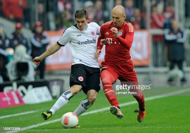 Arjen Robben of Muenchen battles for the ball with Sebastian Jung of Frankfurt during the Bundesliga match between FC Bayern Muenchen and Eintracht...