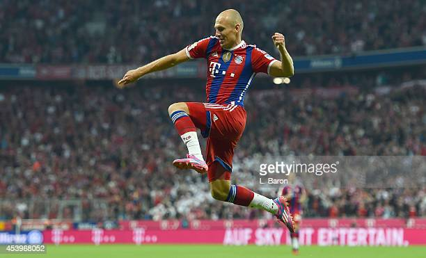 Arjen Robben of Muenchen celebrates after scoring hia teams first goal during the Bundesliga match between FC Bayern Muenchen and VfL Wolfsburg at...