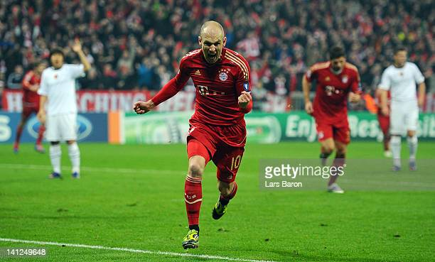 Arjen Robben of Muenchen celebrates after scoring his teams first goal during the UEFA Champions League Round of 16 second leg match between FC...