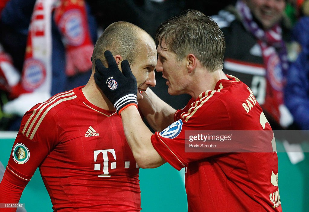 <a gi-track='captionPersonalityLinkClicked' href=/galleries/search?phrase=Arjen+Robben&family=editorial&specificpeople=194740 ng-click='$event.stopPropagation()'>Arjen Robben</a> (L) of Muenchen celebrates after scoring his teams first goal with his team mate <a gi-track='captionPersonalityLinkClicked' href=/galleries/search?phrase=Bastian+Schweinsteiger&family=editorial&specificpeople=203122 ng-click='$event.stopPropagation()'>Bastian Schweinsteiger</a> during the DFB Cup Quarter Final match between FC Bayern Muenchen and Borussia Dortmund at Allianz Arena on February 27, 2013 in Munich, Germany.