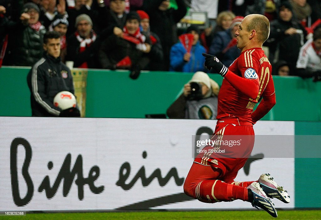 <a gi-track='captionPersonalityLinkClicked' href=/galleries/search?phrase=Arjen+Robben&family=editorial&specificpeople=194740 ng-click='$event.stopPropagation()'>Arjen Robben</a> of Muenchen celebrates after scoring his teams first goal during the DFB Cup Quarter Final match between FC Bayern Muenchen and Borussia Dortmund at Allianz Arena on February 27, 2013 in Munich, Germany.