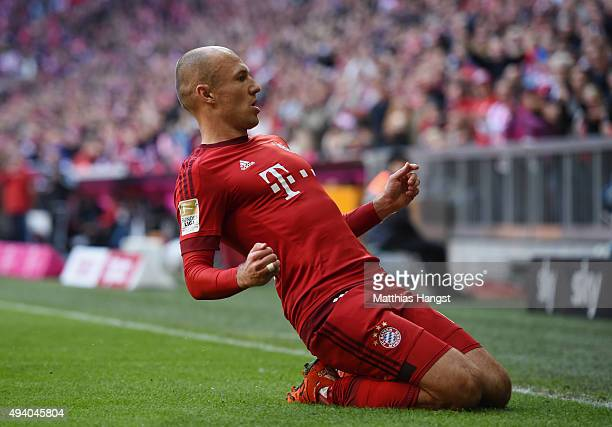 Arjen Robben of Muenchen celebrates after scoring his team's first goal during the Bundesliga match between FC Bayern Muenchen and 1 FC Koeln at...