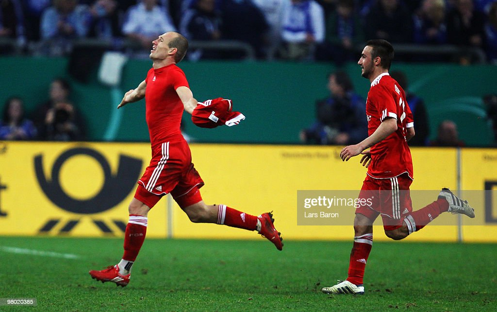 <a gi-track='captionPersonalityLinkClicked' href=/galleries/search?phrase=Arjen+Robben&family=editorial&specificpeople=194740 ng-click='$event.stopPropagation()'>Arjen Robben</a> of Muenchen (L) celebrates after scoring his team's first goal during the DFB Cup semi final match between FC Schalke 04 and FC Bayern Muenchen at Veltins Arena on March 24, 2010 in Gelsenkirchen, Germany.