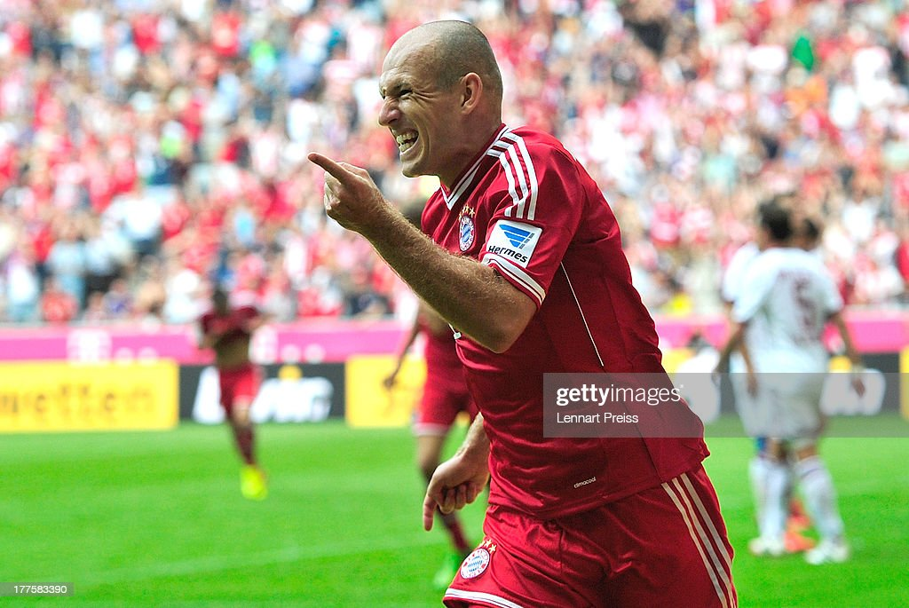 <a gi-track='captionPersonalityLinkClicked' href=/galleries/search?phrase=Arjen+Robben&family=editorial&specificpeople=194740 ng-click='$event.stopPropagation()'>Arjen Robben</a> of Muenchen celebrates his goal during the Bundesliga match between FC Bayern Muenchen and 1. FC Nuernberg at Allianz Arena on August 24, 2013 in Munich, Germany.