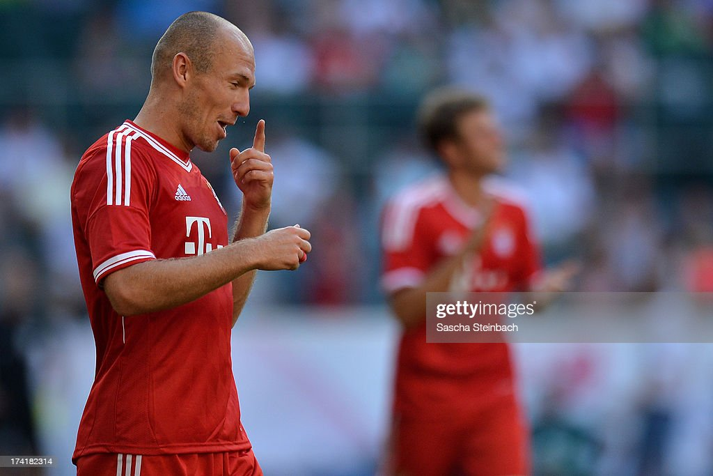 Arjen Robben of Muenchen celebrates his team's 4th goal during the Telekom Cup 2013 final match between Borussia Moenchengladbach and FC Bayern Muenchen at Borussia-Park on July 21, 2013 in Moenchengladbach, Germany.