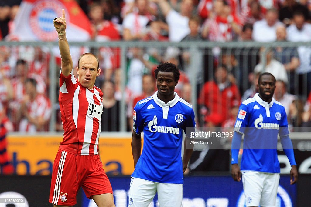 <a gi-track='captionPersonalityLinkClicked' href=/galleries/search?phrase=Arjen+Robben&family=editorial&specificpeople=194740 ng-click='$event.stopPropagation()'>Arjen Robben</a> of Muenchen celebrates his team's first goal as <a gi-track='captionPersonalityLinkClicked' href=/galleries/search?phrase=Anthony+Annan&family=editorial&specificpeople=646720 ng-click='$event.stopPropagation()'>Anthony Annan</a> and <a gi-track='captionPersonalityLinkClicked' href=/galleries/search?phrase=Hans+Sarpei&family=editorial&specificpeople=587816 ng-click='$event.stopPropagation()'>Hans Sarpei</a> (L-R) of Schalke react during the Bundesliga match between FC Bayern Muenchen and FC Schalke 04 at Allianz Arena on April 30, 2011 in Munich, Germany.